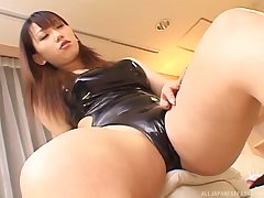 Busty babe Ai Sayama gets talked into jerking a cock in all directions her feet