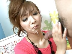 Lovely Asian babe Akimi gets fresh cum close to her enticing face
