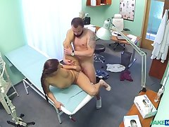 Brunette in tight lodge nurse outfit fucks her patient