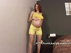 Pregnant Iviola fingers her shaved pussy.