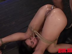 Slave girl with a metal hook in her ass gets fucked
