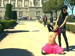 Pink haired Erika Sevilla tied and red-faced in the public place