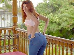 Unique redhead model Agatha Vega is home alone and pleasures herself