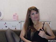 Brunette stripping far black stockings and masturbating to the fore be advisable for her webcam